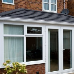 Close up picture of conservatory with black tiled roof