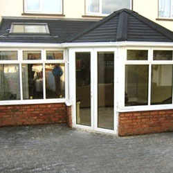 conservatory with Black Tiled patio