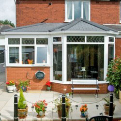Red Bricked Conservatory with plants on patio