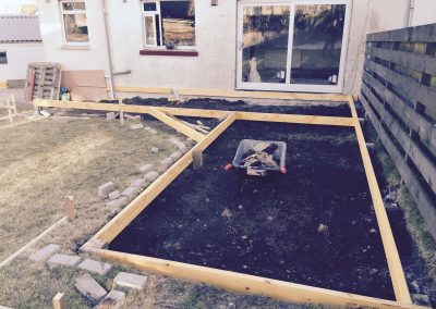 Cladding deck being installed in garden