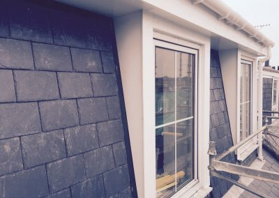Another close up of windows with black brick walls