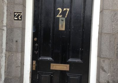black door with number 27