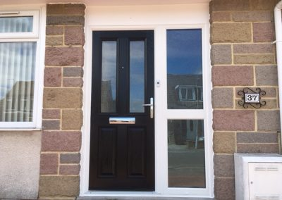 Front door to house with black door with windows