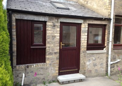 Home Extension with Brown doors and brown window frames