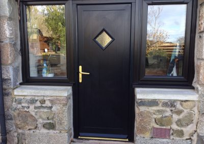 brand new door with diamond window and two windows