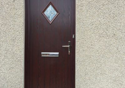 Brown door with diamond window
