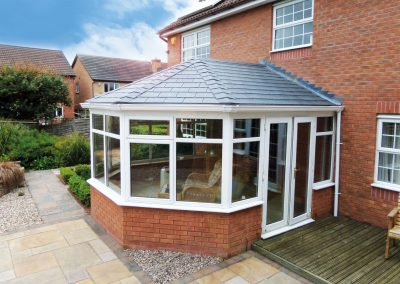 conservatory with grey tile roof in the sun