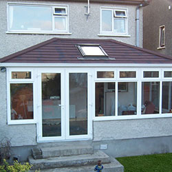 Conservatory with Brown and Black Tiled Roof
