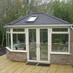Double Hipped Conservatory with Cream Patio Outside
