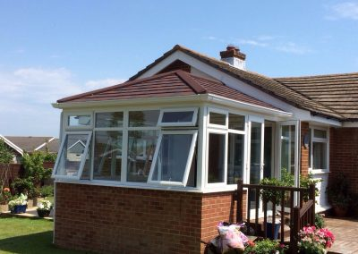 conservatory with decking outside and all windows open