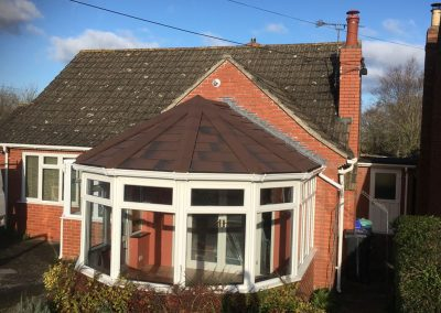 Victorian Conservatory with brown roof